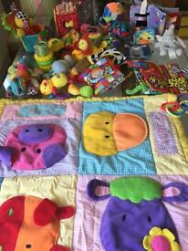 Selection of soft baby toys and interactive mat.