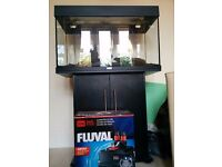 Aquarium (Jewel) including stand, Fluval filter, heater, substrate and decorative wood.