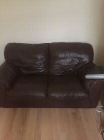 Brown lather sofa and a bed sofa