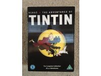 """Tintin 2011 DVD boxed set. """"The complete 21 adventures!"""" Fully remastered classics. Hardly used."""