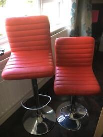 Adjustable red leather bar stools. Used.