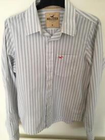 Hollister Men's blue and white shirt.