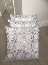 White and silver cushions