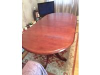 Extending dining table and 6 chairs (2 of which are carvers)