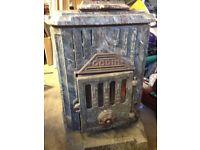 French wood burning stove Made by Godan. Very heavy and very old. In use until removed recenty