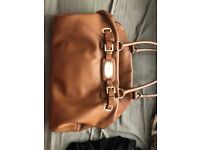 Genuine handbag tanned leather