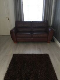 2x2 Seater wine coloured Leather Couch with or without Rug £400 or £200 each & £30 for the rug.