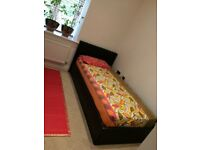 Single ottoman bed ( with almost new mattress) side lift and underneath storage