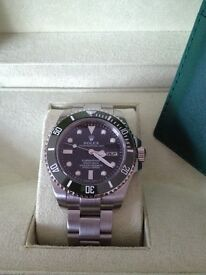 Green face Rolex submariner watch boxed with paper work and bits stainless steel strap