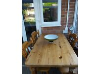 Pine table and 4 chairs. Very good condition.