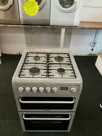 HOTPOINT 60CM DUEL FUEL DOUBLE OVEN COOKER IN LIGHT GREY