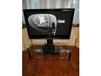 Excellent 42 inch TV with glass stand...