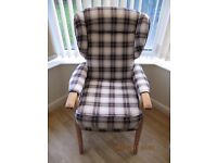 Winged back armchair