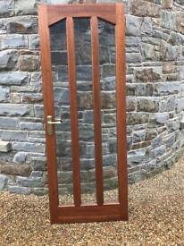 Two wooden glazed doors