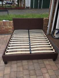 Brown fabric king size bed with mattress
