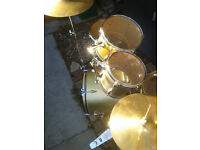 Full working drum kit. 2 tone silver and gold. Crisp, clear tones.