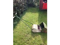 Quality push lawn mower with roller and collection box. Retro well built mower.