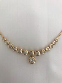 Fourteen round cut dimond necklace