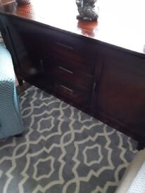 Dark wood solid sideboard would need painted or restrained but solid strong no breakage on it