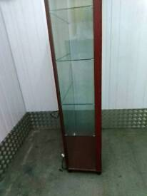 Display glass unit with interior lights and several glass shelves