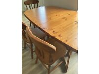 Extending solid wood table with 6 chairs