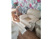 Genuine cream leather reclining armchair with lie flat option.