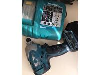 Makita impact driver with battery and charger
