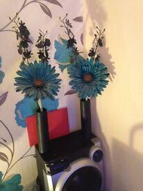 teal flower in vase