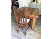 Solid oak extendable dining table and 6 chairs. Antique
