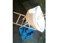 moses basket with wooded stand