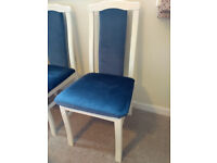 6 White painted wooden dining chairs, re-upholstered in blue velvet material