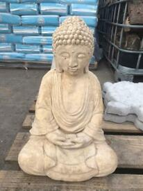Concrete Buddha and stepping stones