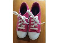 Pair of pink heelys size 3