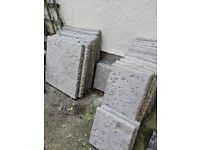 Grey flagstone style paving