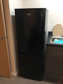 Bush Fridge Freezer for sale due to moving house - 6 month old. Comes with guarantee.