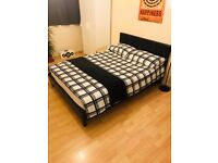 Double bed with mattress - less than 1yr old - £100
