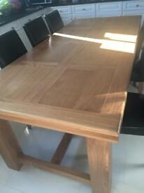 Large oak dining table with chairs