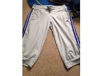 Grey Adidas cropped tracksuit bottoms,