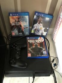 Black PlayStation 4 with Controller.