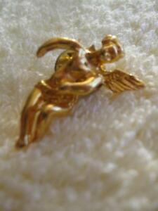 "A VINTAGE ""ANGEL-TO-WATCH-OVER-YOU"" LAPEL PIN"