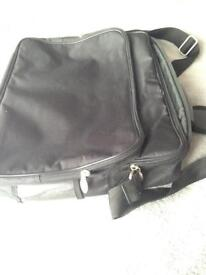 New black laptop bag with shoulder strap and handle