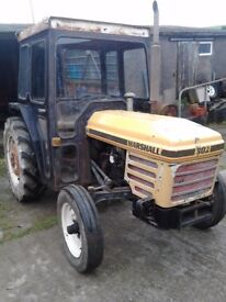 Marshall 302 small diesel tractor with cab.