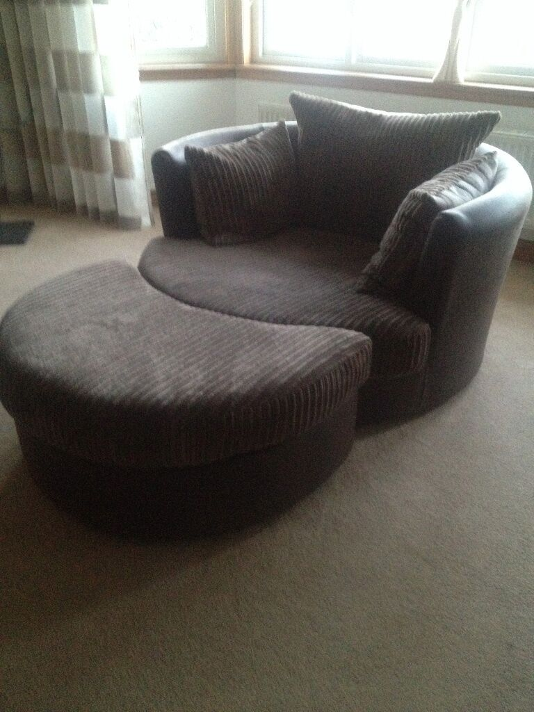 large swivel chair in brown jumbo cord with half moon foot stool
