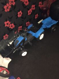 Children's construction tractor with frontloader and trailer.