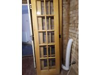 Pair of oak doors with glass inset