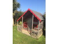 Wooden garden playhouse