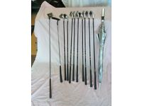 Complete set of Dunlop golf clubs.