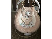 Beautiful neutral baby bouncer