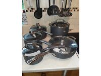 Unused 5 piece pan set for sale. Only selling as unsuitable for induction hob. Buyer collect.