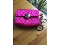 Cerise bag with removable 'gold' coloured chain strap so could be used as a clutch bag.